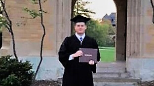 Male college graduate in cap and gown