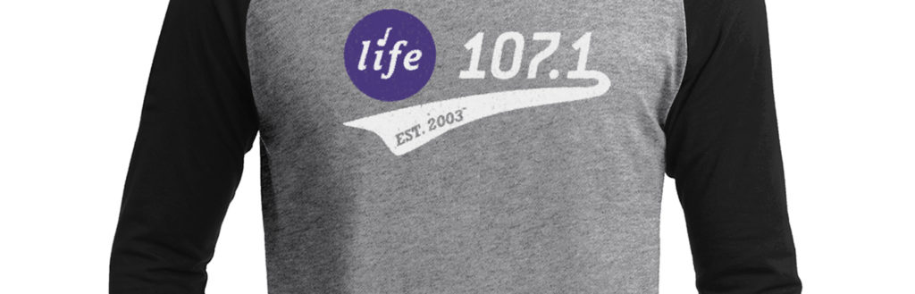 Model wearing a Life 107.1 baseball shirt
