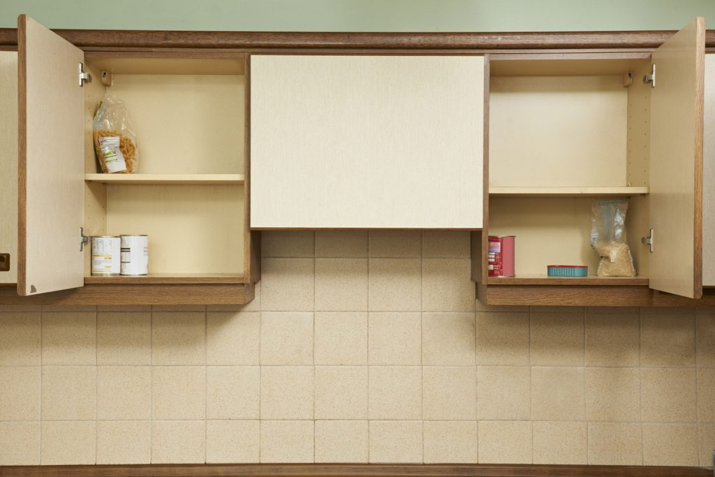 Empty Kitchen Cupboards - Concept image to illustrate harsh economic times