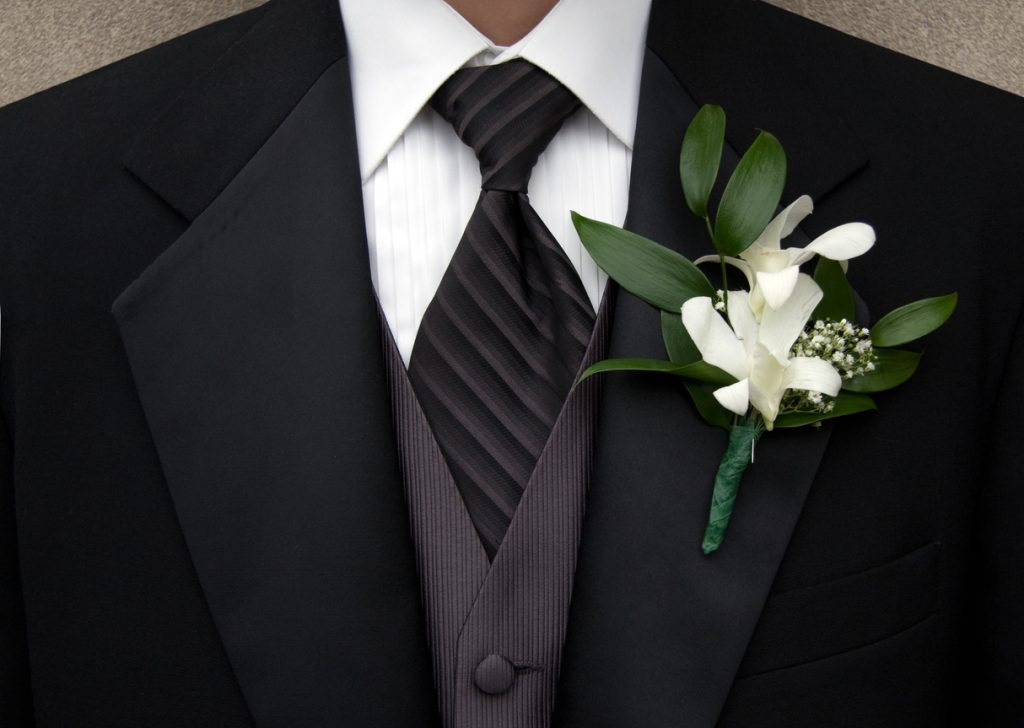 Close up of groomsman wearing Tuxedo. Shallow dof.